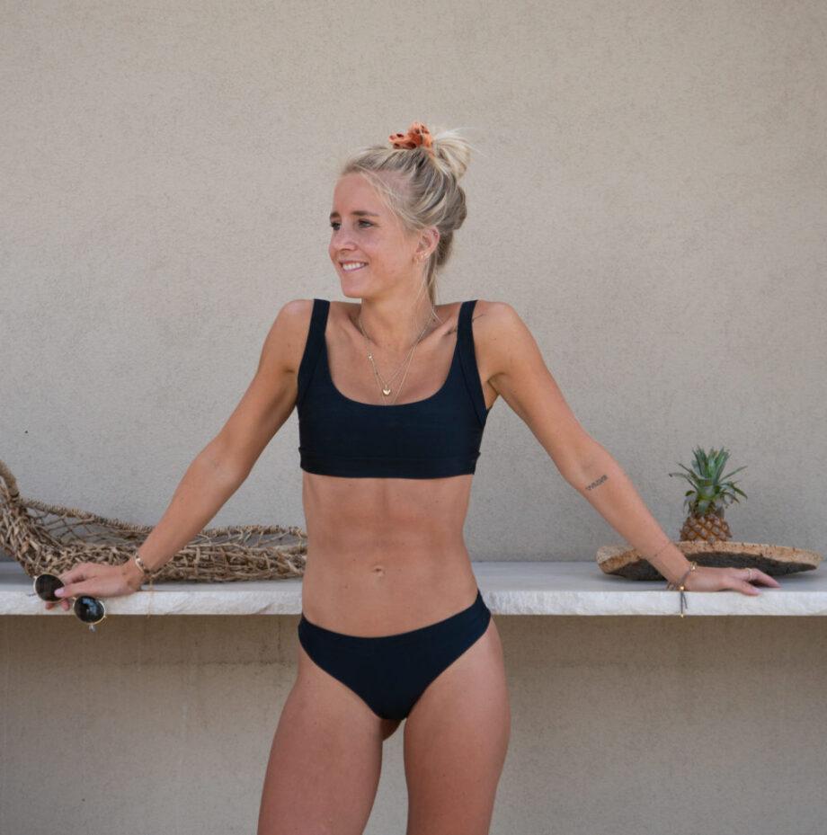 Black bikini with sporty bikini top and high waisted bikini bottoms