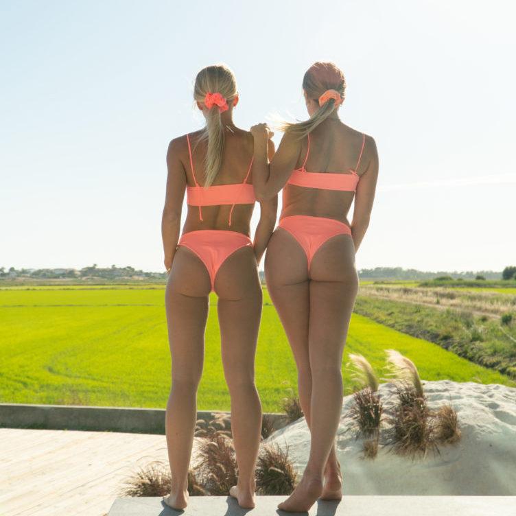 Kim and Kelly Flint in pink high rise bikini