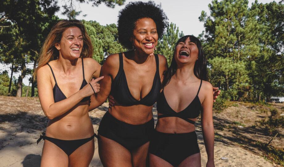 Three happy wondawomen in black mix and match bikini